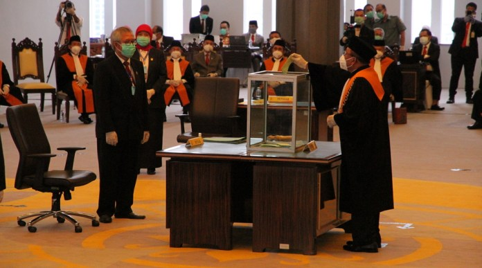 Supreme Court justices, all wearing face masks, voted on Monday to elect a new chief justice in the Supreme Court building in central Jakarta. (Photo courtesy of the Supreme Court)