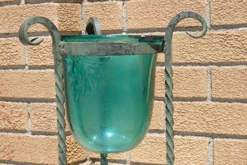 A Gorgeous Wrought Iron Plant Stand With A Large