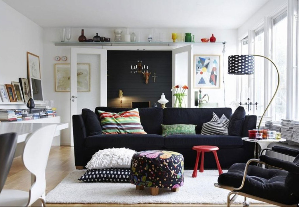 While darker colors make a room seem cozy, they also absorb light instead of reflecting it, making the space feel smaller. Opt for lighter colored flooring as well as wall colors to make the room feel airy.