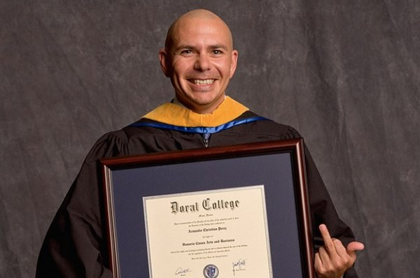 This Photo Of Pitbull Holding An Honorary Degree From A ...