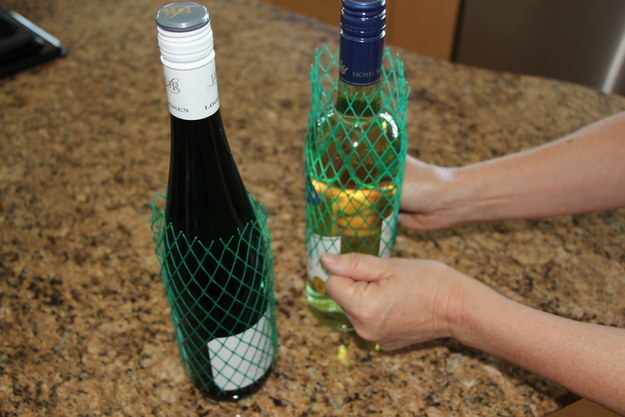 These plastic mesh sleeves will keep your precious wine bottles from noisily knocking into each other.