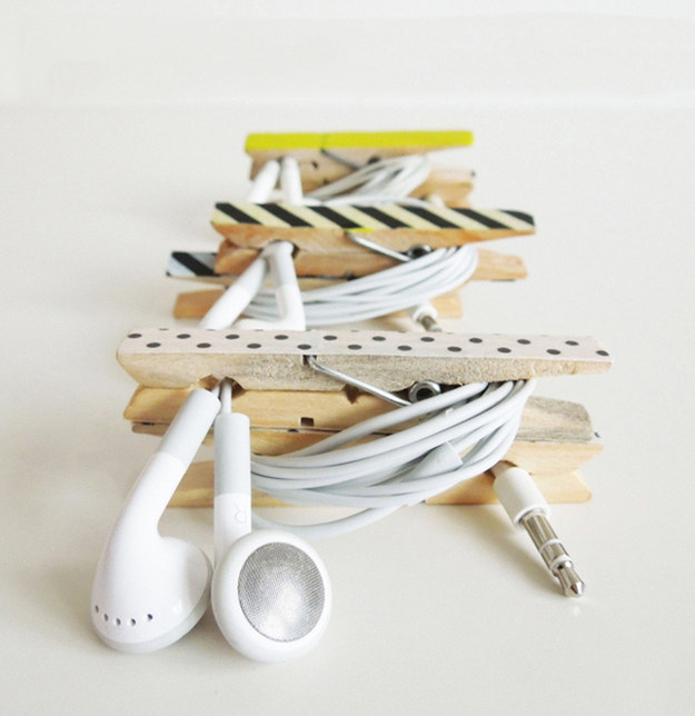 If you constantly misplace your headphones, glue two clothes pins together and make this handy holder.