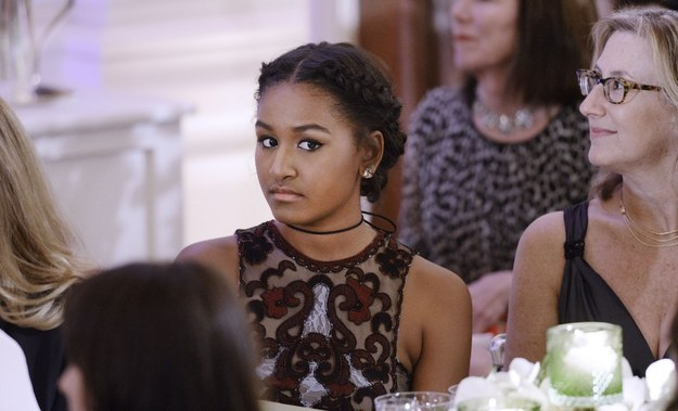 Not to be outdone, Sasha sported a plaited updo and a mahogany-colored dress, complete with a badass choker necklace.