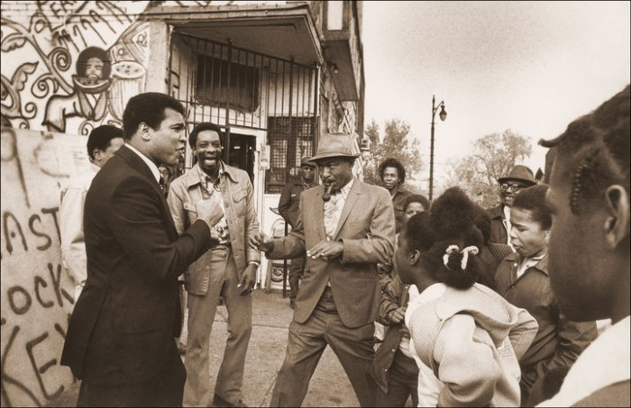Ali on the streets of Detroit, Michigan, 1977, having stopped the limo so he could meet some fans.