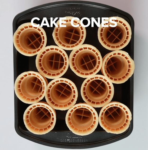 LIne up a bunch of flat-bottomed cake cones in a rimmed cake pan.