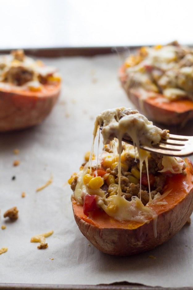 Roast turkey, corn, and smoked gouda right inside half a sweet potato.