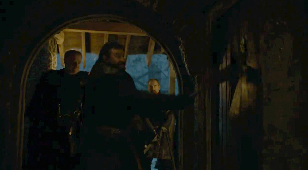 From here the whole trailer starts to move pretty quickly. Back in Castle Black Ser Alliser Thorne is trying to knock down a door.