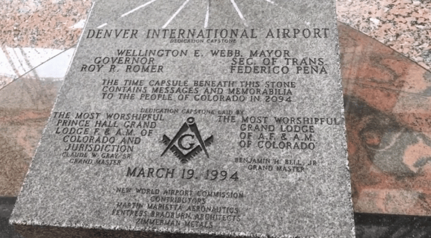 The airport's dedication stone has imagery from a secret society.