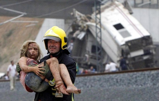 And this fireman helping a little girl after the same incident.