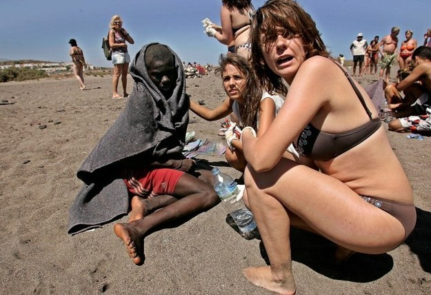These beachgoers helping migrants who have just arrived on the coast of Tenerife.