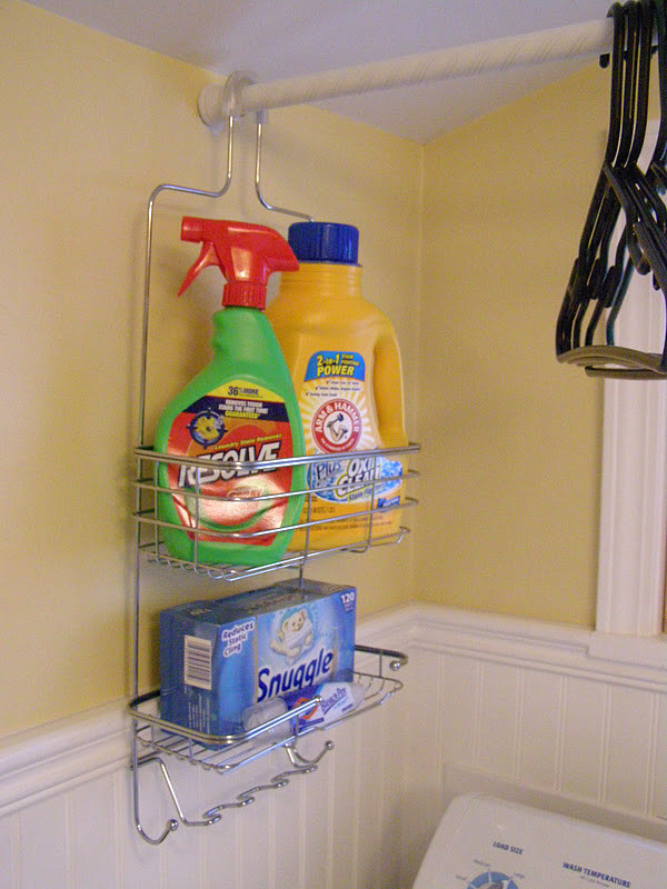 Or if you're super short on storage space, hang up a shower curtain rod above your washer/dryer, and use a shower caddy to store your detergent.