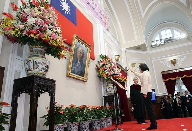 """This is the moment of a solemn ceremony when Tsai, or """"Xiao Ing"""" — as her Taiwanese fans affectionately caller — took her oath of office before a portrait of Sun Yat-sen, the first president of the Republic of China inside the Presidential Palace in Taipei."""