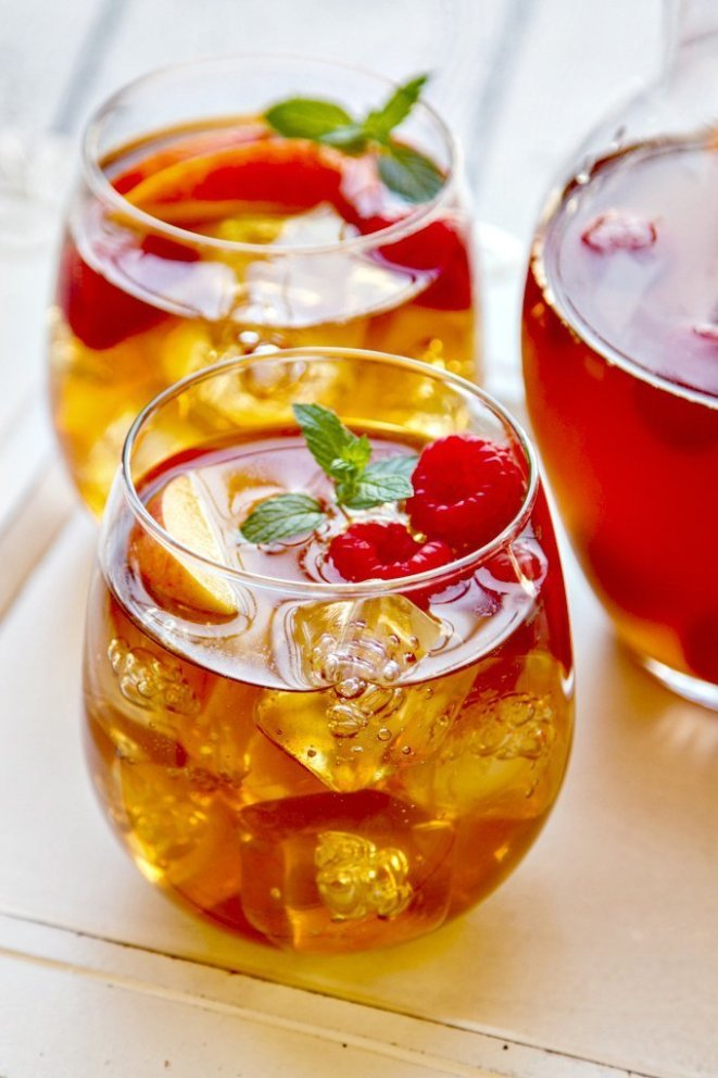 You can also add a pour of peach liqueur to make it extra fruity. Here's the recipe for sweet tea punch with peaches and raspberries.