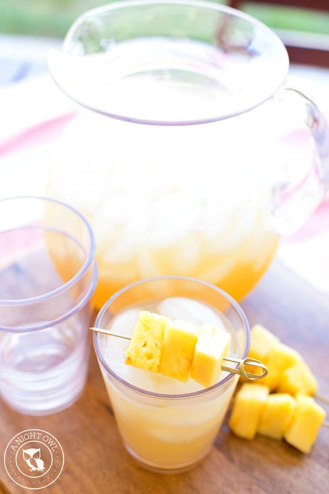 Rum, juice, ginger ale, and a few pineapple chunks bring the summer vacation straight to your kitchen. Here's the recipe for pineapple rum punch.