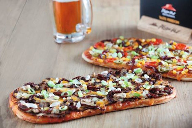 Pizza Hut is attempting to make getting your hops a little easier by testing out a pizza that has craft beer infused in its dough.