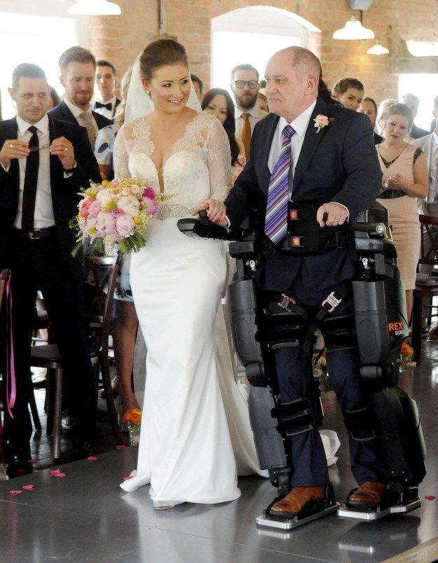 A paralysed father, who was told by doctors in 2012 that he would never walk again, got the chance to walk his daughter down the aisle on her wedding day with the help of a bionic suit.