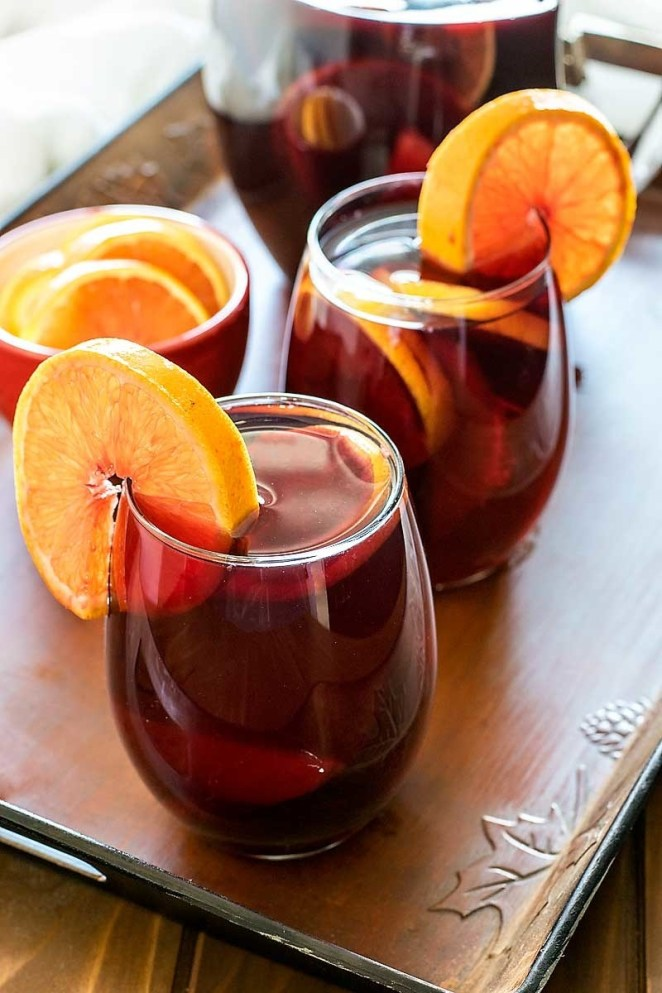 Because you don't have to stick to the standard citrus and berries. Here's the recipe for mango Cointreau sangria.