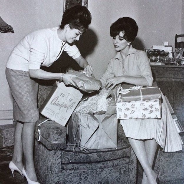 Joan Collins shared this photo of her and her late sister, Jackie Collins, opening presents.