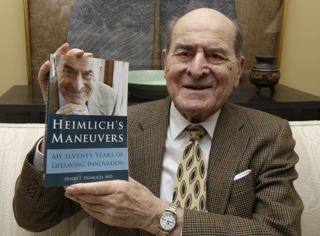 Dr. Henry Heimlich, the 96-year-old inventor of the Heimlich maneuver, used his own technique for the first time to save a woman who was choking on a piece of hamburger, the Cincinnati Enquirer reported.