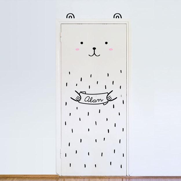 A customizable bear to stick to a door.