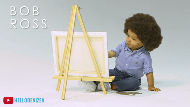 This little cutie patootie found the joy in painting by dressing like Bob Ross.