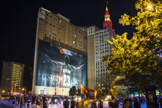 The 10-story banner of LeBron James placed on the side of the Sherwin-Williams headquarters in downtown Cleveland after James returned to the Cavaliers in 2014 will be taken down for 90 days and replaced with a banner aimed at visitors for July's Republican National Convention.