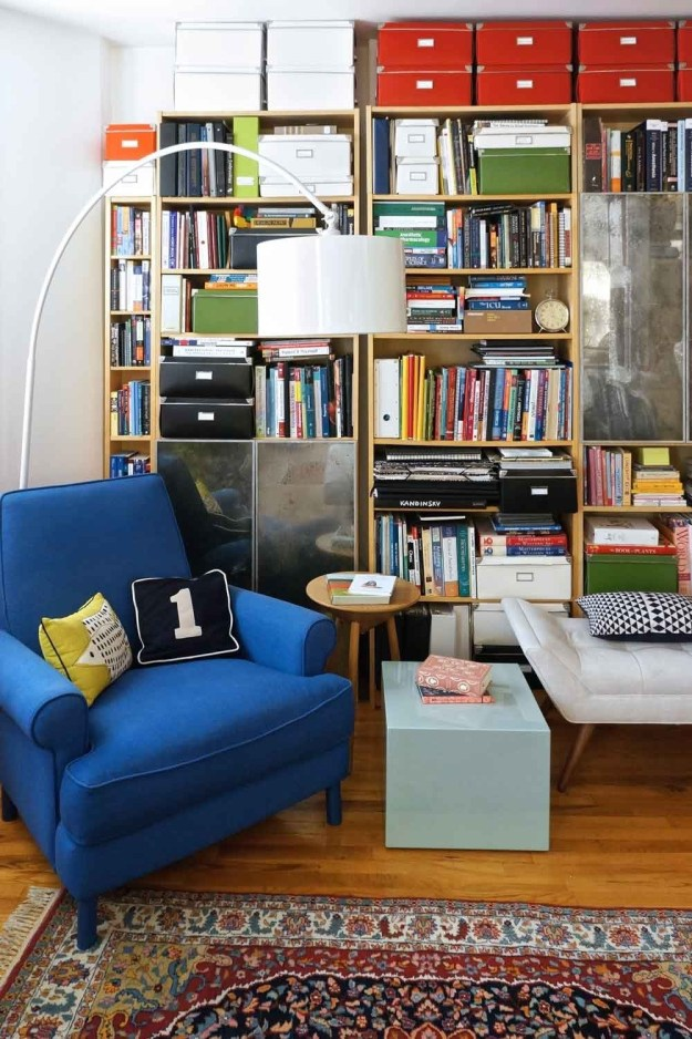 Embrace controlled clutter by covering a wall floor-to-ceiling with shelving and coordinated bins.