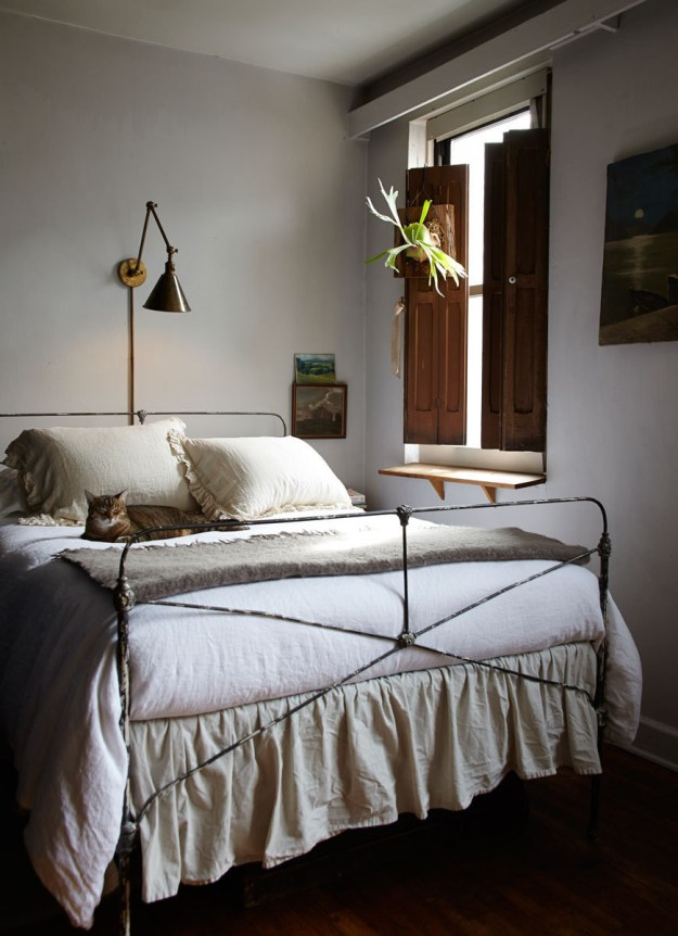 Hang wall sconces above your bed when you have no space for a lamp on your beside table.