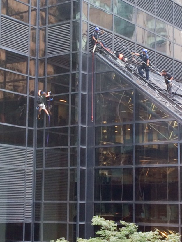 The man could be seen climbing the building at the corner of 5th Avenue and 57th Street without safety ropes around 4 p.m. ET.