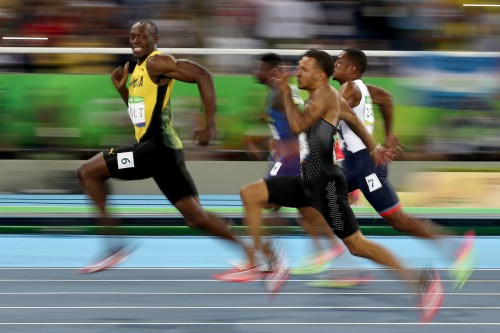 The world's fastest man, Usain Bolt, competed in the men's 100-meter semi final today just 30 minutes before winning gold in the final, and breezed past the competition with absolute ease. So much so, he took time to turn his head and give his competitors a cheeky smile.