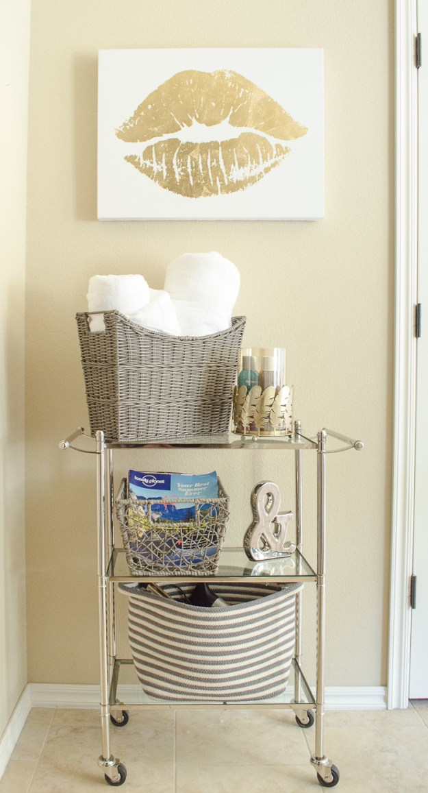 Add more space to a storage-hungry bathroom by wheeling in a bar cart.