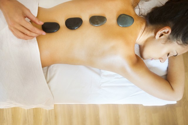 Hot stones can be used in tandem with massage to help soothe tense, aching muscles and increase blood flow to bring quick relief.