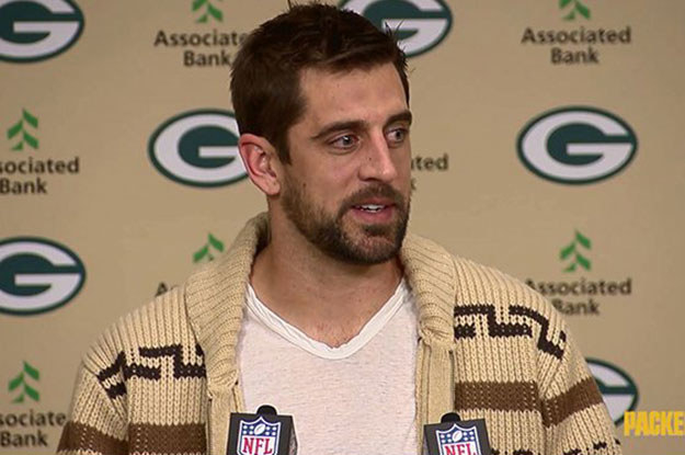 Packers quarterback Aaron Rodgers showed up to last night's post-game press conference in a sweater than looks suspiciously like another famous cardigan.