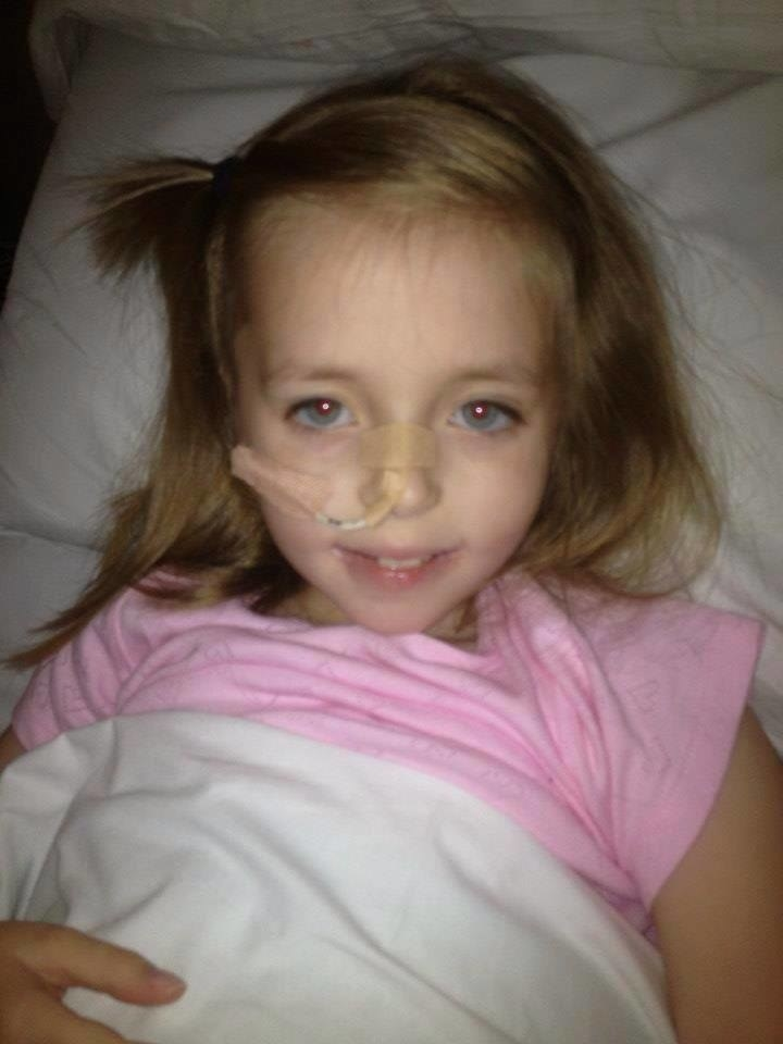 """""""My daughter Ellie was diagnosed with severe Crohn's disease in September 2012 when she was 7 years old. She become unwell quite quickly, though the doctors and even the hospital dismissed it as a virus, followed by lingering virus. I knew there was more to it – this was not like anything I had seen before with a virus. She was going to the bathroom 12 times a day, and in the end I took her back to A&E. They sent her home within a couple of hours, but shortly after we arrived home she had collapsed. """"She was taken to a different hospital where they admitted her. She was then transferred to Alder Hey Children's Hospital where she was taken into theatre for camera studies. The consultant told us she had severe Crohn's disease – she had it in patches in different ares of her digestive system. """"Now, at the time she was diagnosed, I thought, Great, we know what we are dealing with, she will have a specialist feed for six weeks via NG [nasogastric] tube, where it will be the sole source of nutrition, and she will be okay. """"I didn't know an awful lot about it. It was quite hard to adjust at first – I worried about her, how she was feeling. After all, she was the one in all the pain, she was the one suffering. I hurt from a parent's perspective – I saw my beautiful little girl look so frail and vulnerable. Yet she smiled. She never complained."""" – Donna Pugh"""