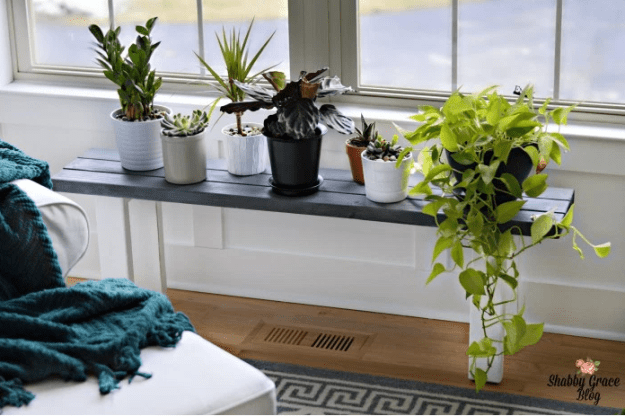 Build a narrow plant stand to keep your green friends in their favorite sunbeams longer.