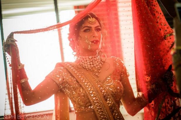 The bride looked stunning in her wedding lehenga, designed by Abu Jani and Sandeep Khosla.