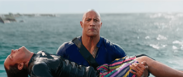The teaser begins with The Rock, saving the life of a would-be drowning victim...