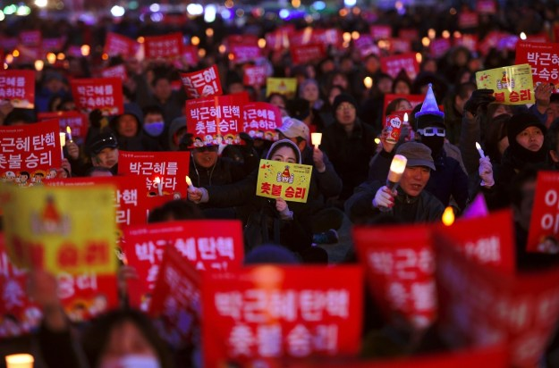 People at the rally held up red banners reading