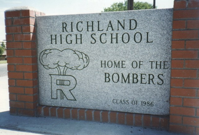 Richland is home to the Hanford nuclear site, which supplied plutonium for the nuclear bomb detonated over Nagasaki, which is why their symbol is a MUSHROOM CLOUD with the catchphrase 'Nuke 'em 'til they glow!' and 'Proud of the cloud!' Get ? rid ? of ? this ?