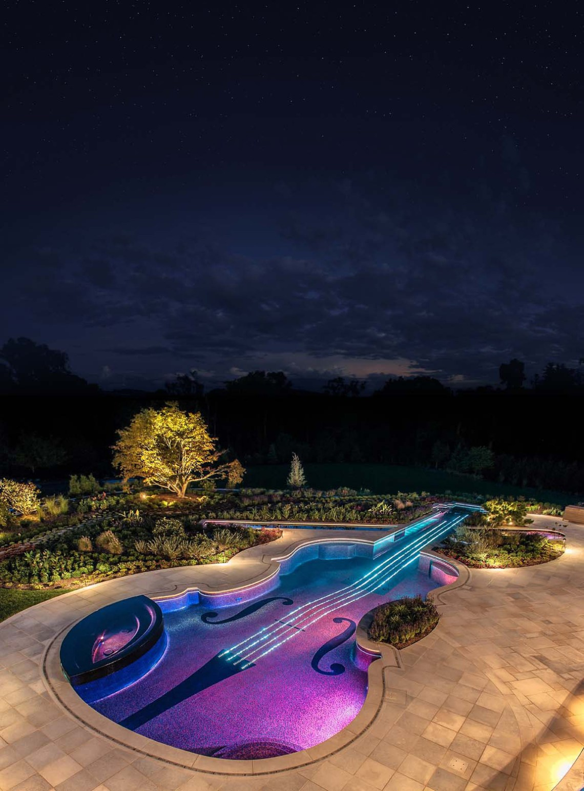 The violin's bow is actually two koi ponds — that you can see while underwater because of two thick acrylic panels. You can check out process photos and more pictures on Cipriano Custom Swimming Pools & Landscaping.