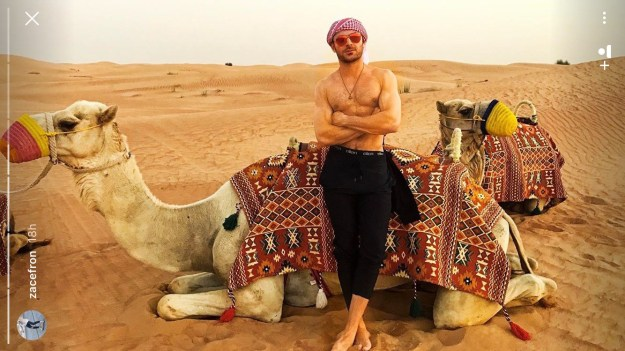 What I'm about to tell you is gonna sound like a Mad Lib written by a horny middle schooler: Zac Efron rode camels barefoot and shirtless in the United Arab Emirates desert on Monday...