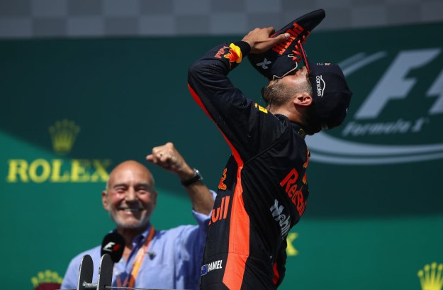 He appeared on the podium with Australian driver Daniel Ricciardo, who came third in the race.