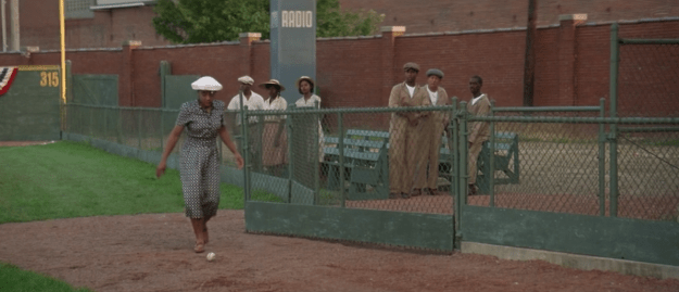 """During one game, a baseball falls near the segregated """"colored"""" section of the stadium."""