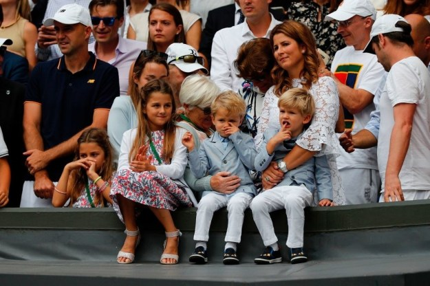 Federer's wife, Mirka, and their two sets of twins were in the stands to see their dad make history.