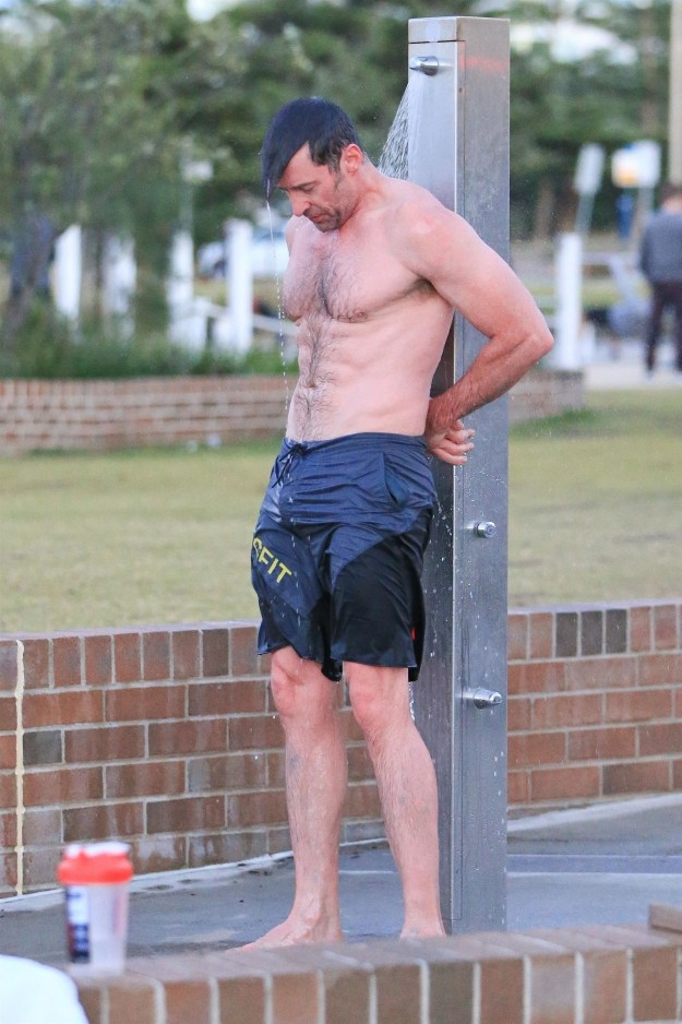 Hugh was spotted showering over at Bondi Beach in Sydney on Thursday and it's truly the reason cameras were invented: