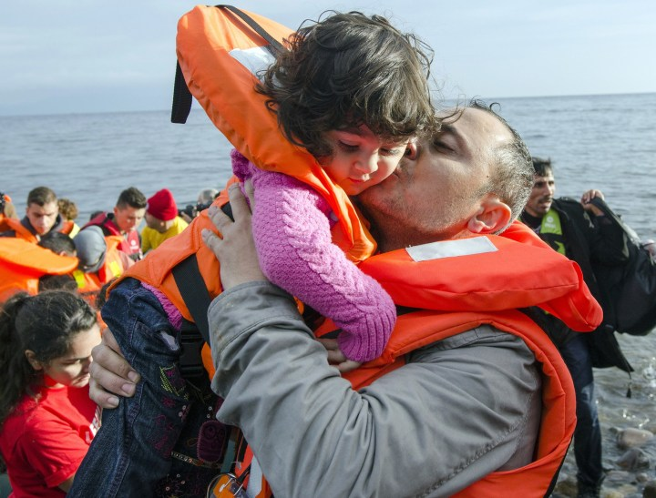 21. And this touching moment when a refugee offered a kiss of comfort to a little girl after arriving on the shores of Lesbos Island, Greece, in 2016: