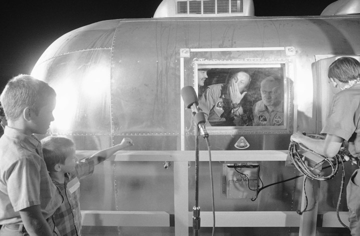 7. Neil Armstrong blowing a kiss to his two sons while in quarantine after being the first man to ever walk on the moon in 1969: