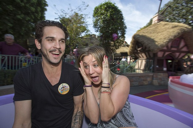 Kaley Cuoco barely handling the Mad Tea Party teacups ride.