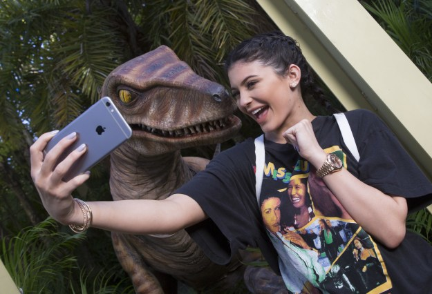 Kylie Jenner taking a selfie with a Velociraptor.