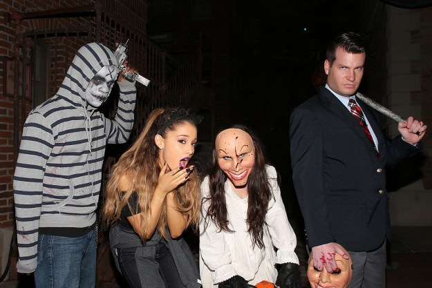 Ariana Grande hanging with some terrifying Purge characters at Halloween Horror Nights.